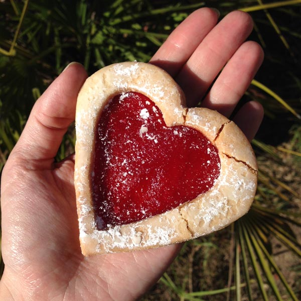 hand holding a Linzer heart cookie from Susina Bakey in Los Angeles