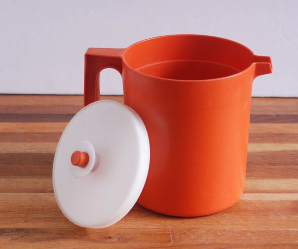 Orange Tupperware juice pitcher