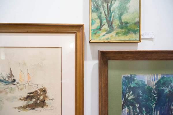 Vintage paintings at City Issue midcentury modern boutique in Atlanta; photo by Finely Crafted