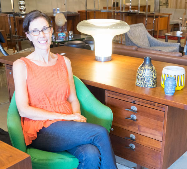 Jennifer Sams, owner of City Issue midcentury modern boutique in Atlanta; Lesbo lamp; Jens Risom walnut desk; photo by Finely Crafted